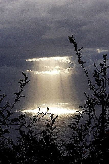 Light shining through the clouds representing the light within us that shines through our clouded minds.